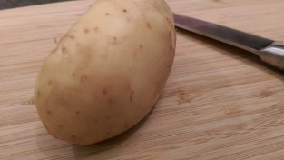 Potato set on newly cut bottom