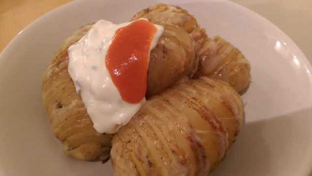 Hasselback Potatoes with sour cream and sriracha